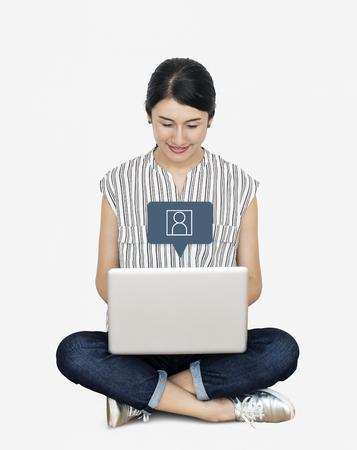 Happy Asian woman using her laptop Banco de Imagens
