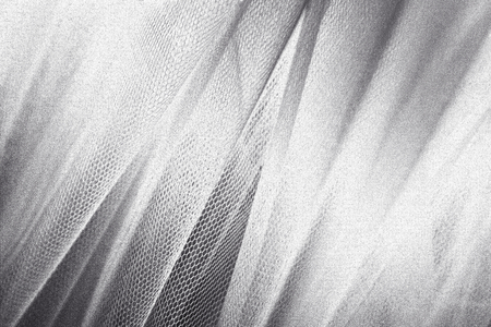 Silky silver fabric snakeskin textured background