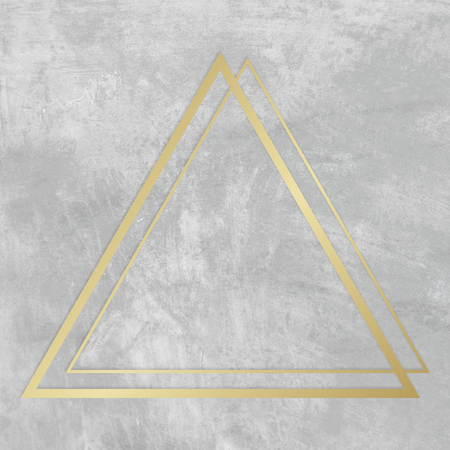 Gold triangle frame on a gray concrete textured background Banco de Imagens