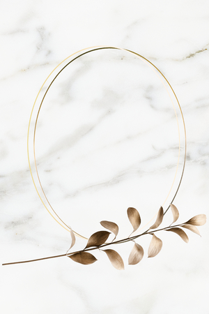 Oval golden frame on a marble background