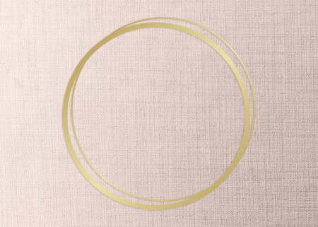 Gold round frame on a peach fabric background