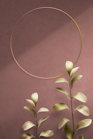 Round golden nature frame on a pink background 免版税图像