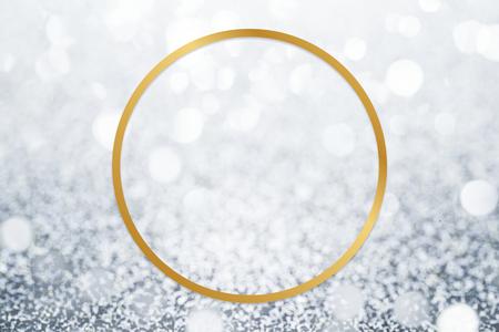Golden framed circle on a glitter texture