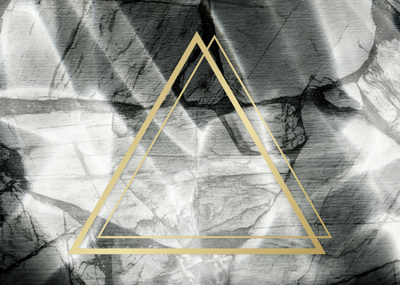 Golden framed triangle on a marble texture Banco de Imagens