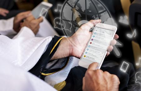 Priest using his mobile phone