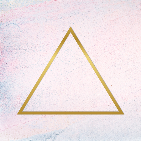 Gold triangle frame on a pastel concrete background