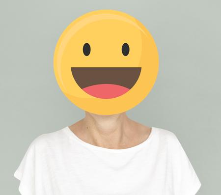 Happy face emoji portrait on a woman Archivio Fotografico - 121110708