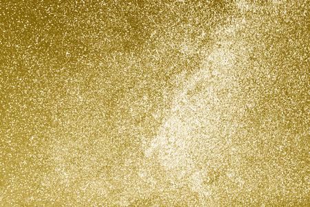 Shiny gold glitter textured background Foto de archivo
