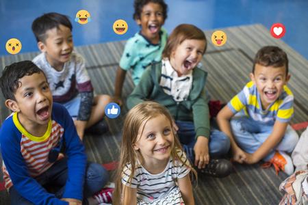 Cheerful elementary kids in school Stock Photo
