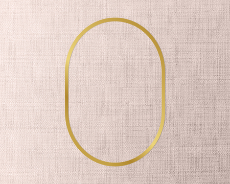 Gold oval frame on a peach fabric background
