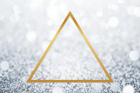Golden framed triangle on a glitter texture Фото со стока