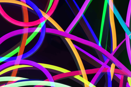 Colorful light lines on a black background vector