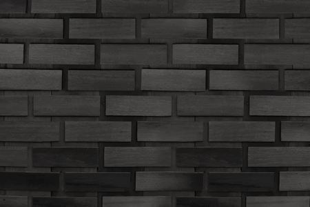 Black brick wall textured background vector