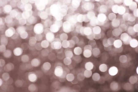 Blurry copper bokeh textured background vector