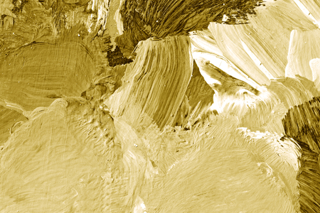 Gold oil paint brush stroked textured background 版權商用圖片