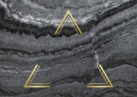 Gold triangle frame on a gray marble textured background Фото со стока