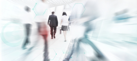 Blurry motion of business people walking in a city