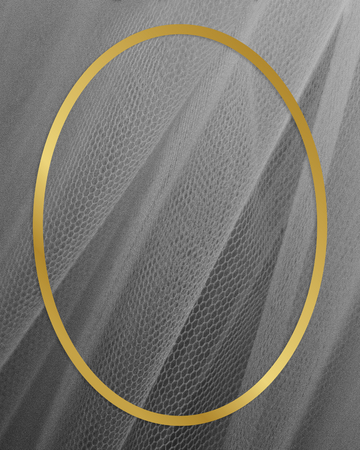 Golden framed oval on a gray fabric texture