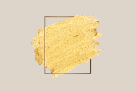 Gold paint with a golden rectangle frame on a beige background Stok Fotoğraf - 122905797