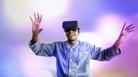 Black man enjoying a VR experience