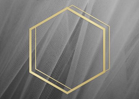 Golden framed hexagon on a gray fabric texture 写真素材