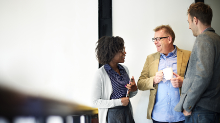 Coworkers talking during a coffee break Stock Photo