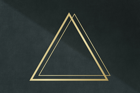 Gold triangle frame on a dark gray concrete textured background