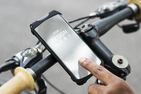 Cyclist using a phone on a bike Фото со стока