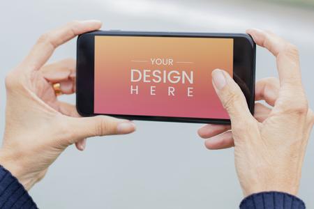 Woman holding a phone mockup