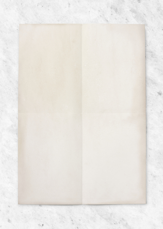Folded paper on a marble background Stock Photo