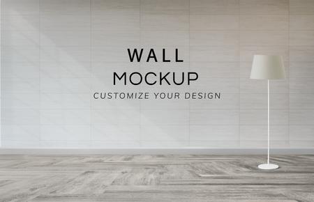 Lampada contro un modello di muro bianco