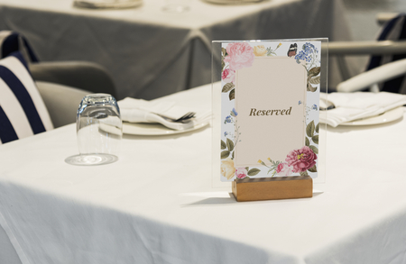 Reserved framed card mockup on the table Stock Photo