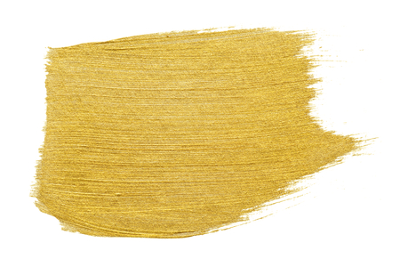 Trazo de pincel dorado aislado sobre fondo blanco.