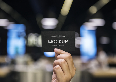 Hand holding a black card mockup Stock Photo