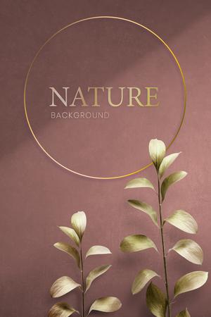 Round golden nature frame on a pink background Foto de archivo