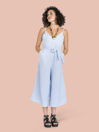 Woman in a blue jumpsuit character isolated on pastel pink background