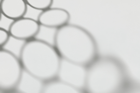 Shadow of connected circles on a white wall