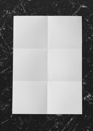 Creased white paper on a marble background