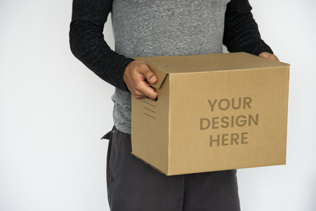 Man carrying a kraft box mockup