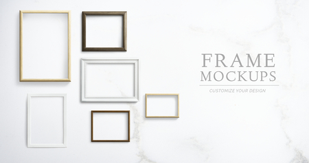 Various frame mockups against a wall