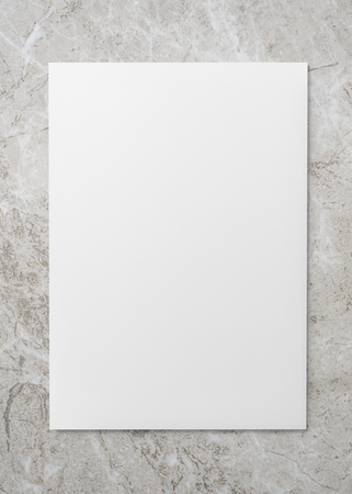 White paper on a gray marble background Banco de Imagens