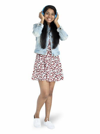 Cheerful Indian girl listening to the music character isolated on a white background 스톡 콘텐츠