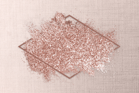 Pink gold glitter with a rhombus frame on a pink textile background illustration