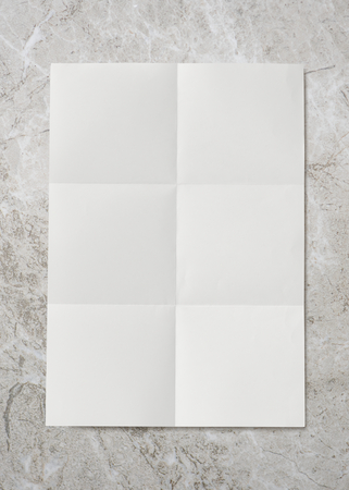 Folded paper crease on marble background