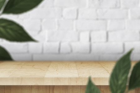 Wooden table with leaves on a white brick wall product background Imagens - 123234527