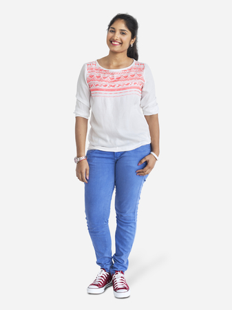 Cheerful Indian young woman in jeans character isolated on a white background