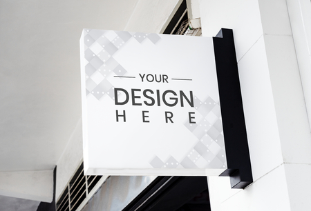 White signage mockup on a wall