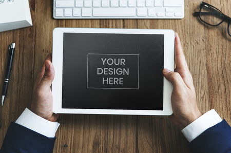 Digital tablet mockup on a wooden desk