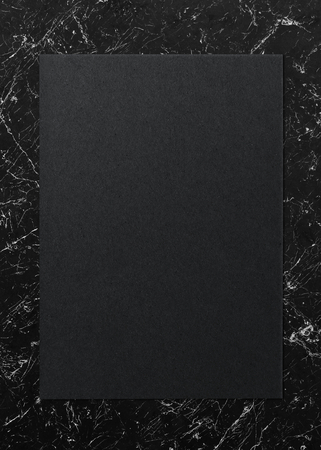 Black paper on a marble background