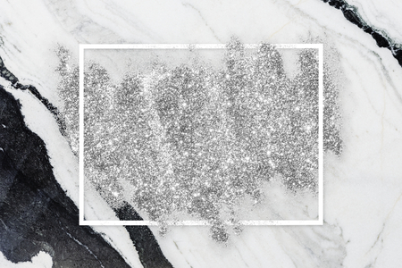Silver glitter with a white frame on a white marble background illustration